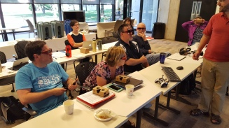 Workshop participants wear special 3D glasses to see images on the ROVR.