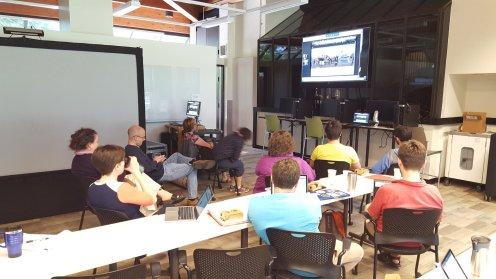 Workshop participants listen to a presentation by Dr. Joel Beeson.